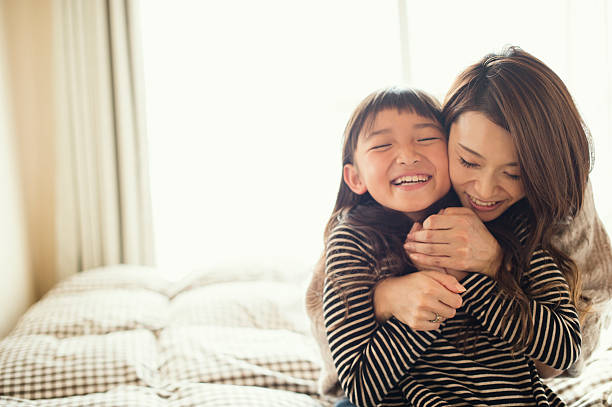 Mother and daughter playing in bed room Mother and daughter having fun time in bed room 8 9 years stock pictures, royalty-free photos & images