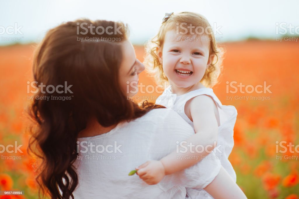 mother and daughter playing in flower field - Royalty-free Adult Stock Photo