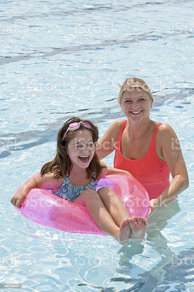 Mother and Daughter Playing in the Pool royalty-free stock photo