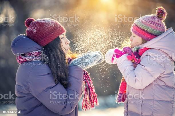 Mother and daughter playing in winter park picture id1074147794?b=1&k=6&m=1074147794&s=612x612&h=lijdeieivctimugrs3jcc2kpkexddnxr6w5sso5krdi=