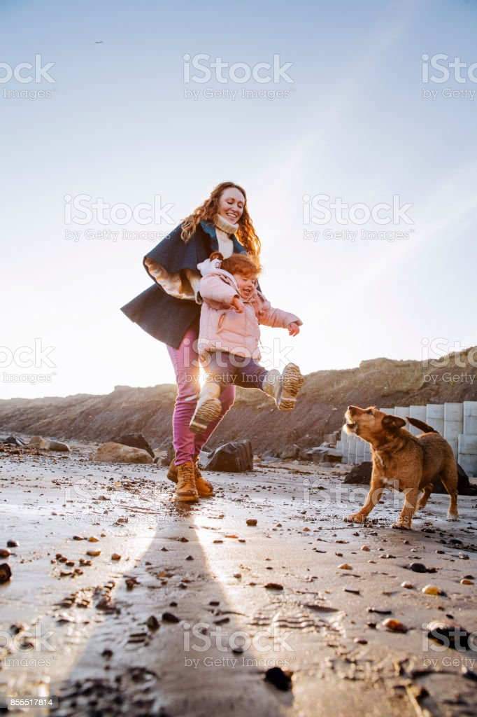 Mother and Daughter Playing on the Beach stock photo