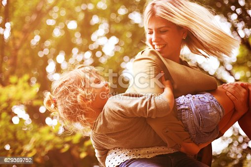 istock Mother and daughter playing outdoor. 629369752