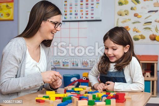 872316662 istock photo Mother and Daughter Playing Together with colorful building toy blocks 1008271082