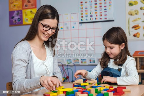 872316662 istock photo Mother and Daughter Playing Together with colorful building toy blocks 1008271150
