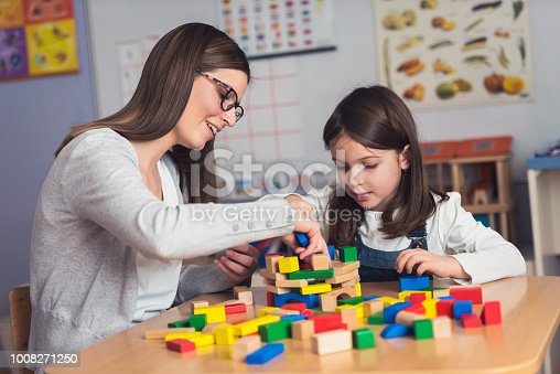 872316662 istock photo Mother and Daughter Playing Together with colorful building toy blocks 1008271250