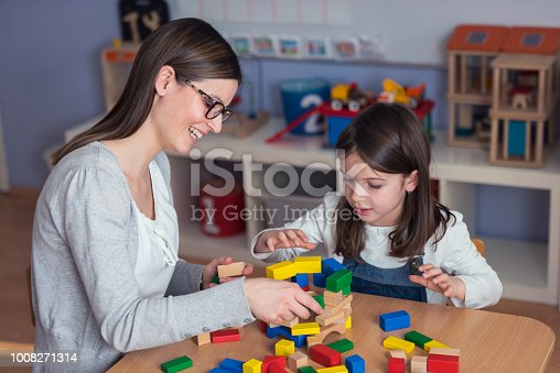 872316662 istock photo Mother and Daughter Playing Together with colorful building toy blocks 1008271314