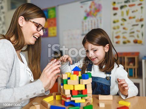 872316662 istock photo Mother and Daughter Playing Together with colorful building toy blocks 1008413050