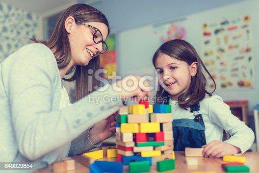 istock Mother and Daughter Playing Together with colorful building toy blocks 640029854