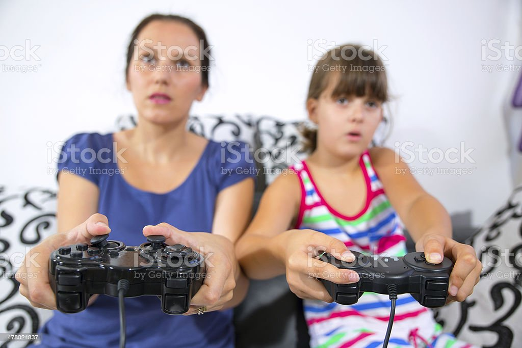 Mother and daughter playing video games royalty-free stock photo