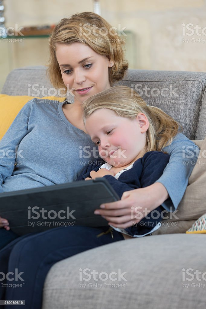 mother and daughter playing with tablet royalty-free stock photo