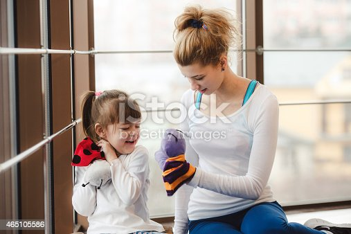 istock Mother and daughter playing with toys in the gym 465105586