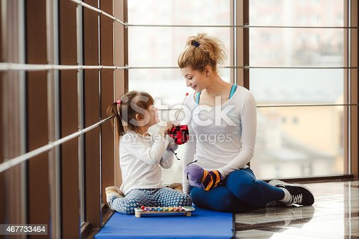 istock Mother and daughter playing with toys in the gym 467733464