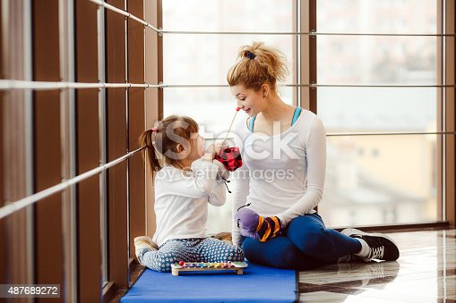 istock Mother and daughter playing with toys in the gym 487689272