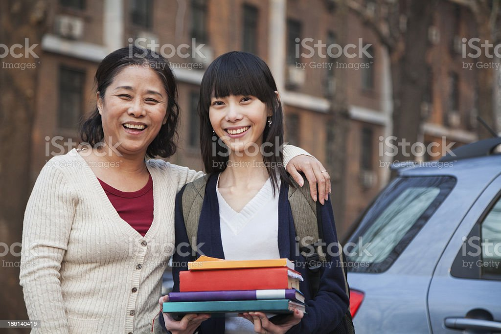 Mother and daughter portrait in front of dormitory stock photo