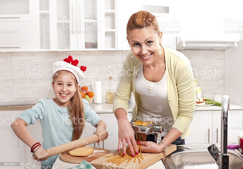 Mother and daughter preparing pastry products royalty-free stock photo