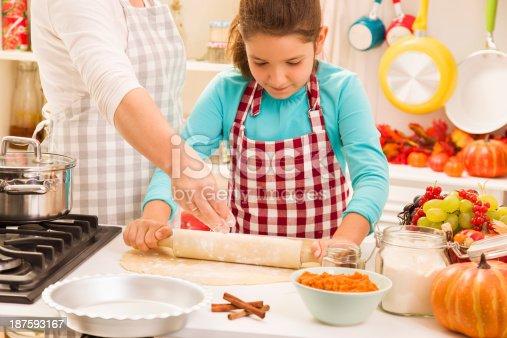 istock Mother and daughter preparing pumpkin pie 187593167