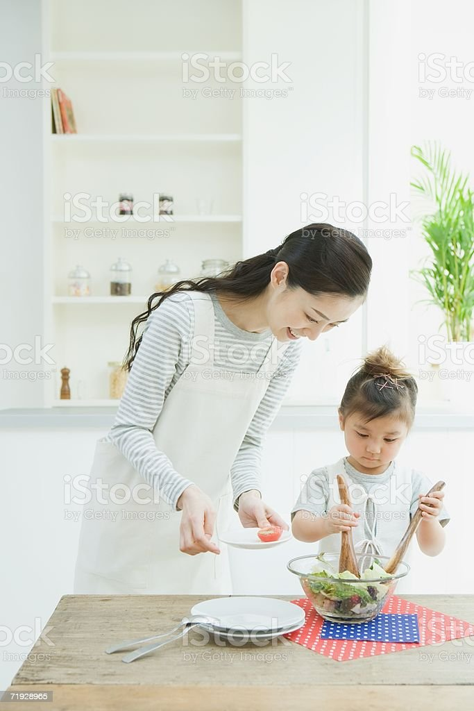 Mother and daughter preparing salad royalty-free stock photo