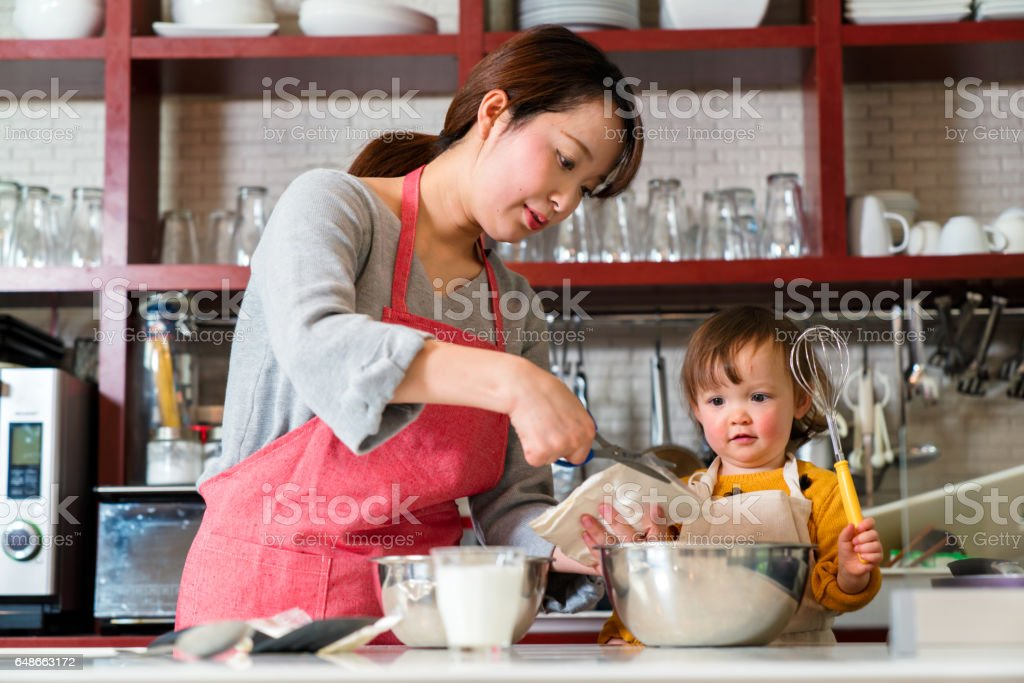 Mother and daughter preparing to cook royalty-free stock photo