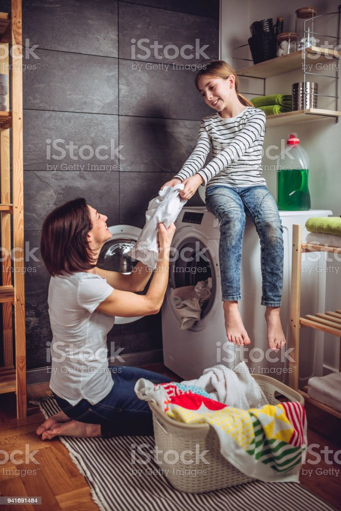Mother And Daughter Enjoy The Washing Machine