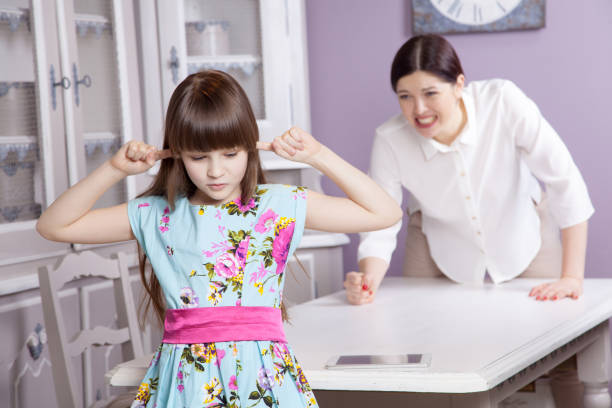 mother and daughter quarrel because of overuse technology - kids online abuse stockfoto's en -beelden