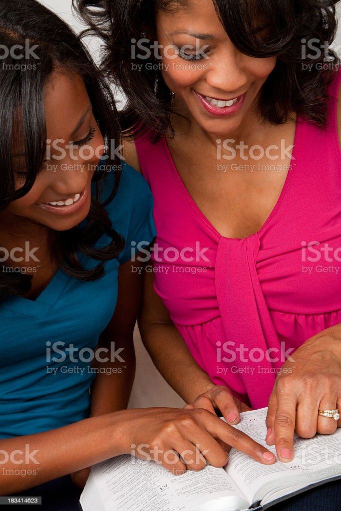Mother and daughter reading royalty-free stock photo