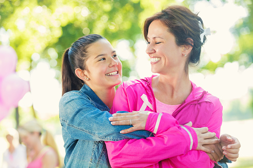 Mother and daughter registering for breast cancer awareness charity race