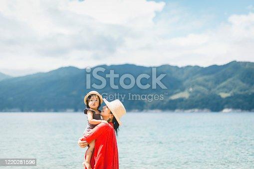 Asian family playing at seaside.