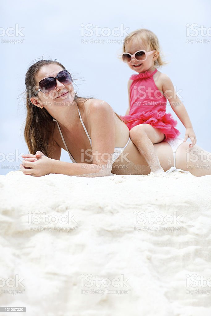 Mother and daughter relaxing at beach royalty-free stock photo