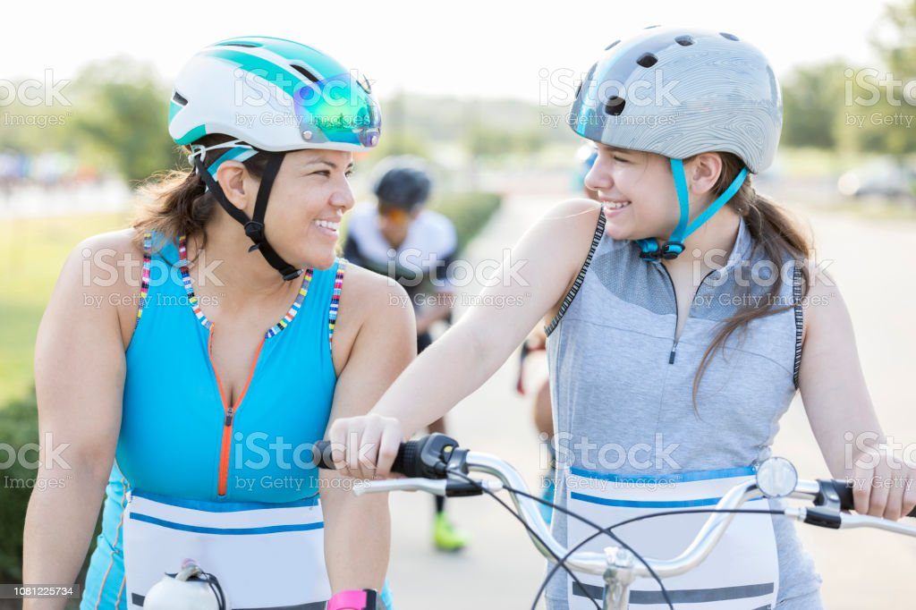 Mother And Daughter Ride Side By Side In Bike Race For