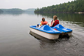istock A mother and daughter riding a pedelo wearing life jackets 94178906