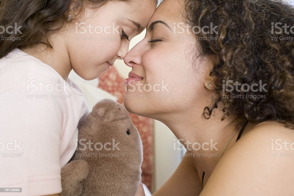 Mother and daughter rubbing noses stock photo