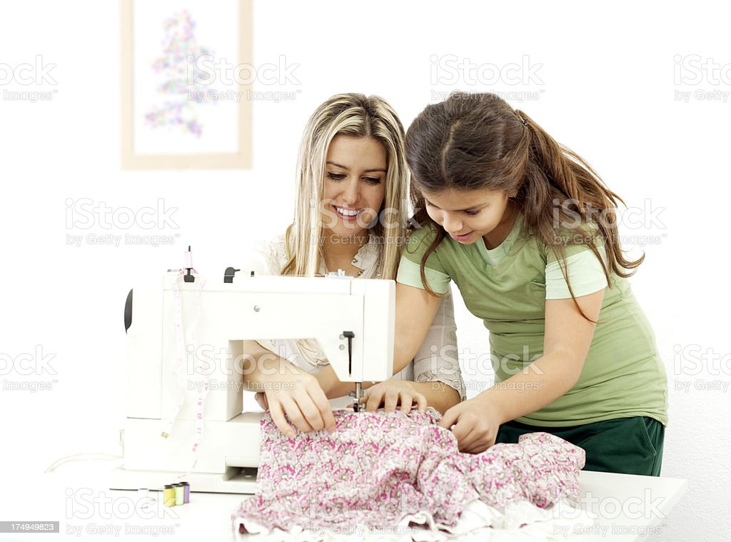 Mother and daughter sewing royalty-free stock photo