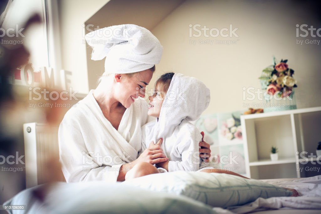 Mother and daughter share love between etch other. stock photo