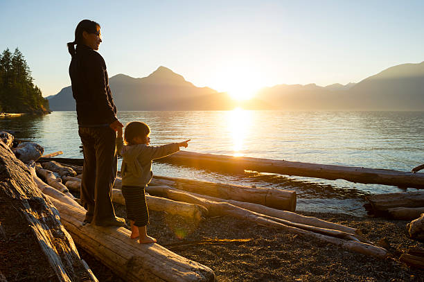 mother and daughter sharing a connection - canada travel stock photos and pictures