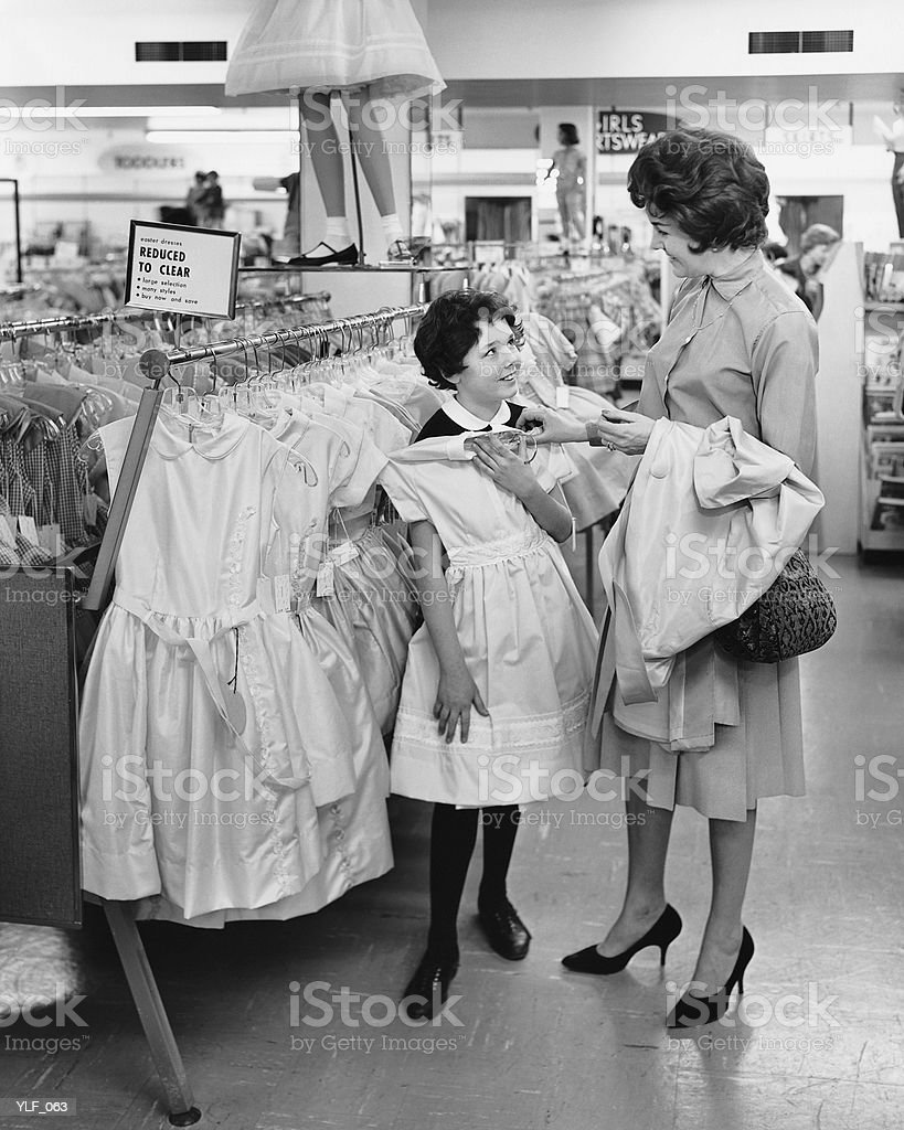 Mother and daughter shopping for clothes royalty-free stock photo