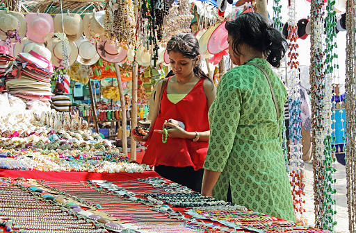 Mother And Daughter Shopping In Flea Market Stock Photo - Download Image Now