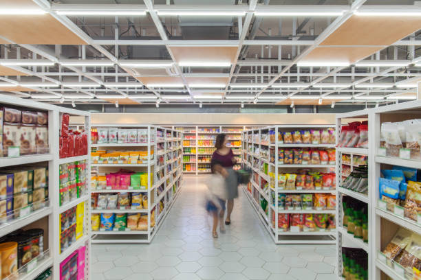 Mother and daughter shopping in supermarket Mother and daughter shopping in supermarket snack aisle stock pictures, royalty-free photos & images