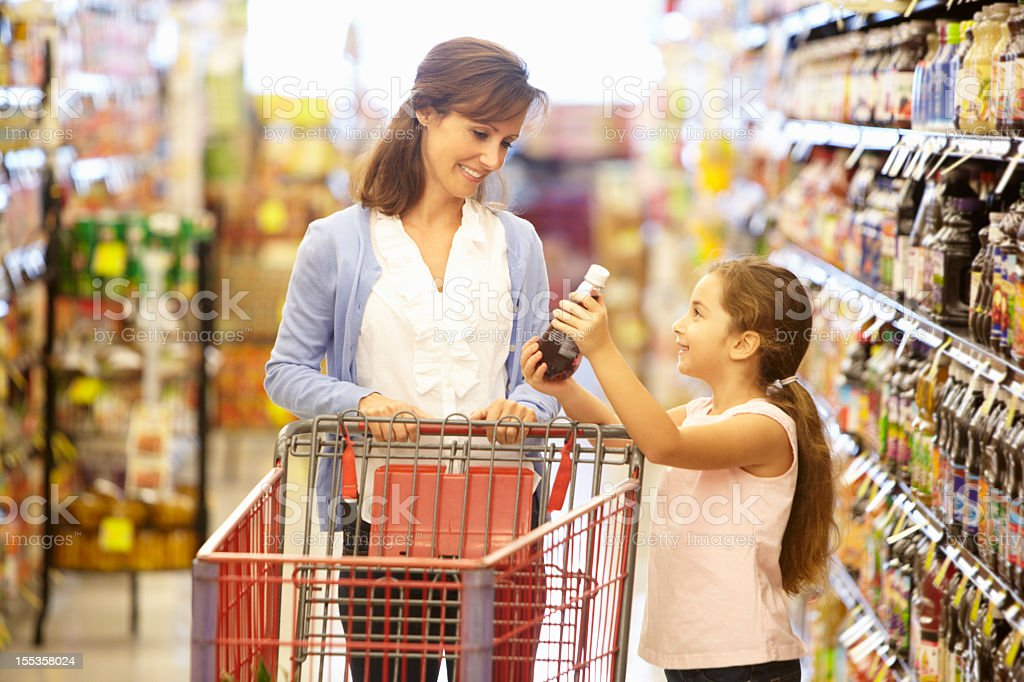 Mother and daughter shopping in supermarket royalty-free stock photo