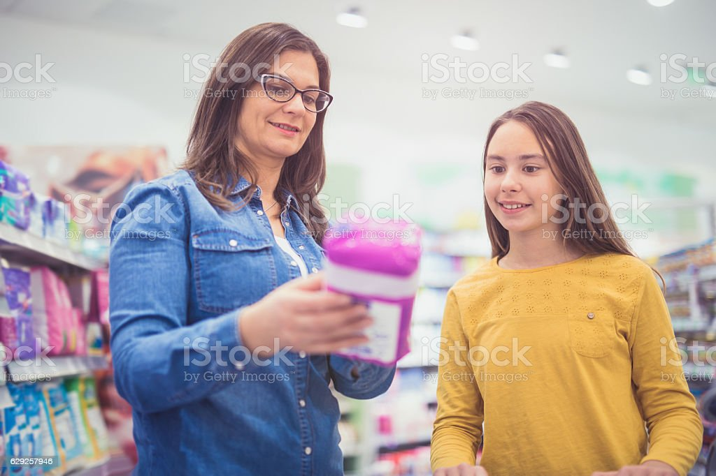 Mother and daughter shopping sanitary pad stock photo