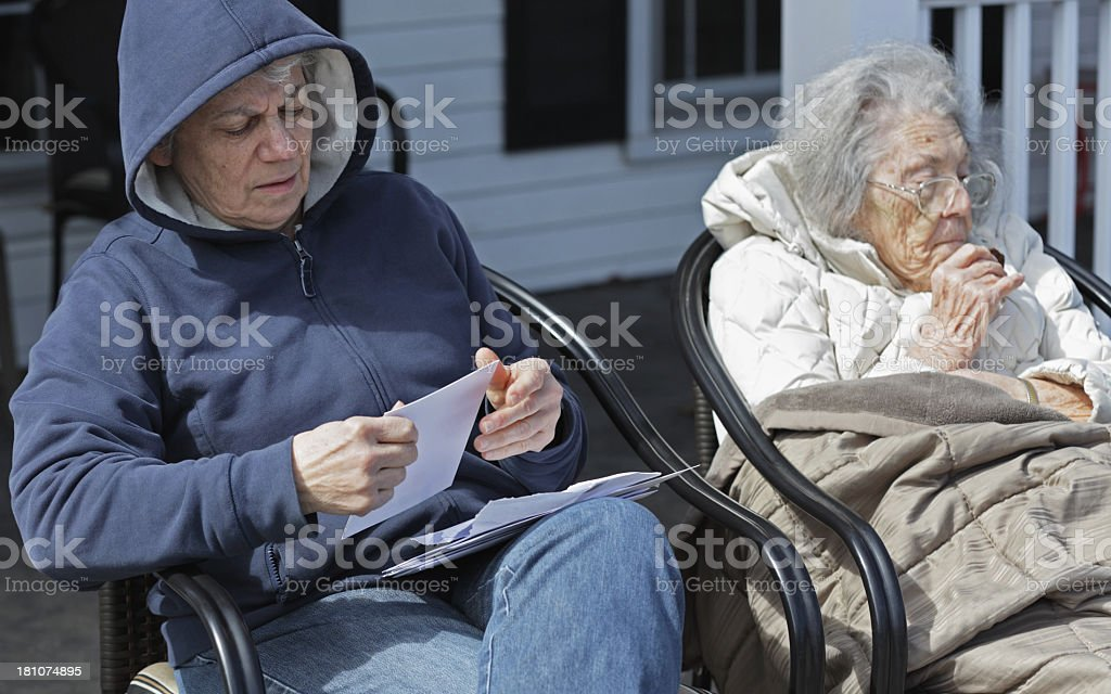 Mother And Daughter Sitting Together Outside royalty-free stock photo