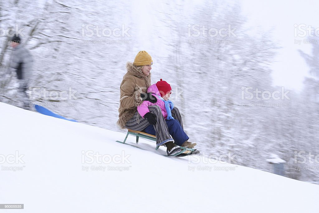 Mother and daughter sledging royalty-free stock photo