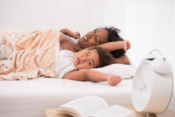 Mother and daughter sleep late. stock photo