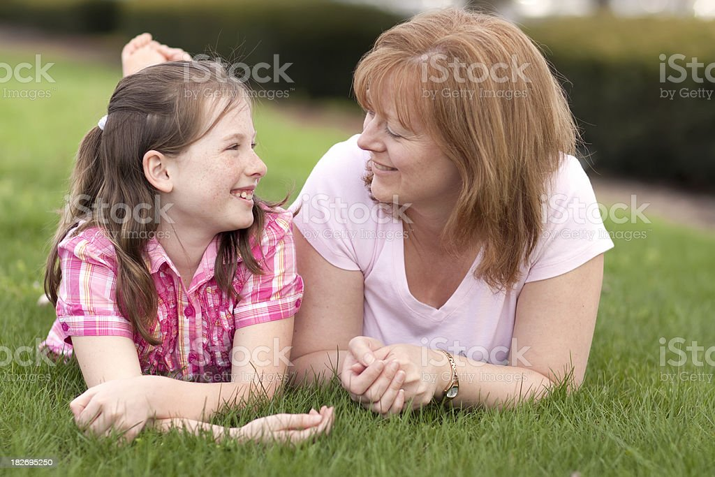 Mother and daughter smiling on grass (Series) royalty-free stock photo