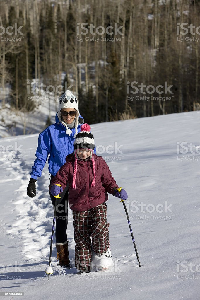 Mother and Daughter snowshoeing royalty-free stock photo