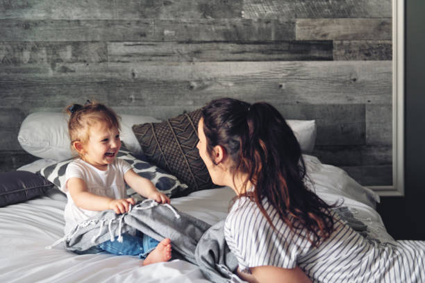 Mother and daughter spending a week-end morning together stock photo