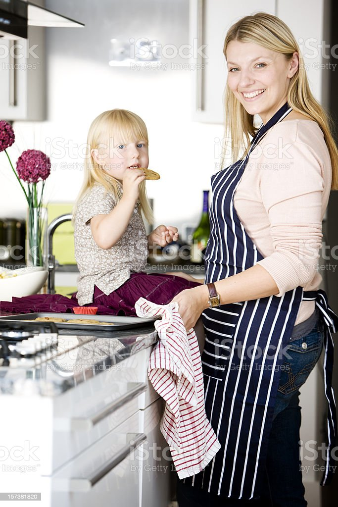 Mother and daughter spending time together baking in the kitchen royalty-free stock photo