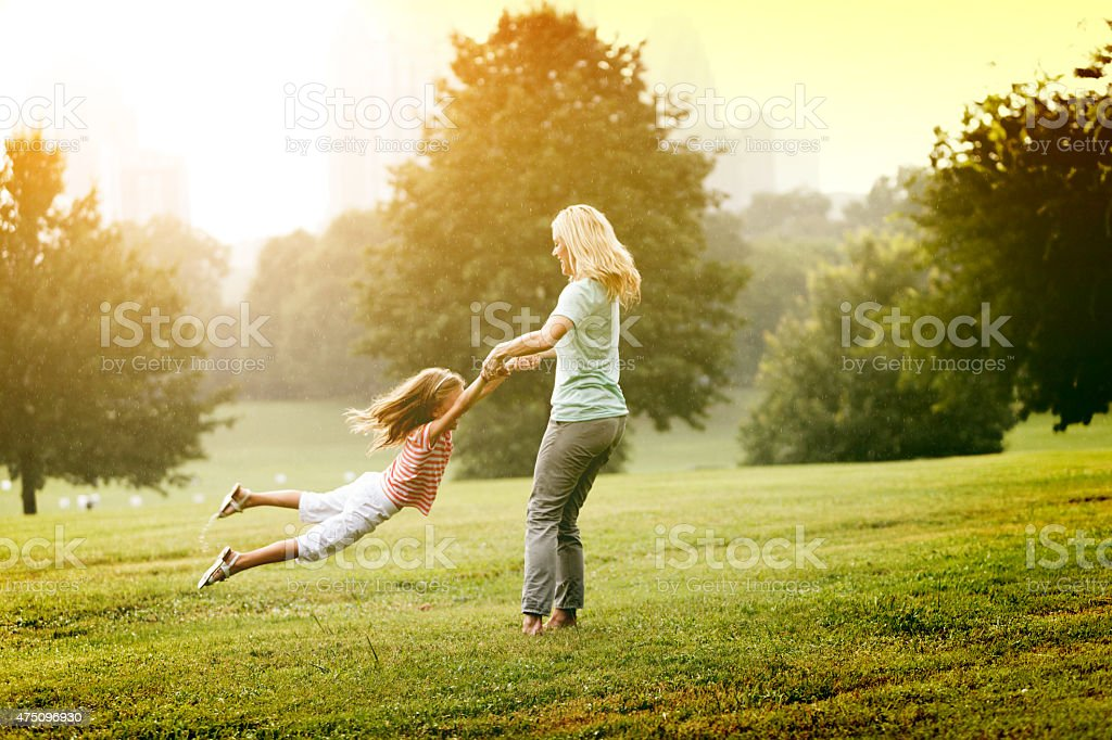 Mother and Daughter Spinning stock photo