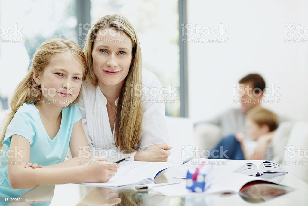 Mother and daughter studying together royalty-free stock photo