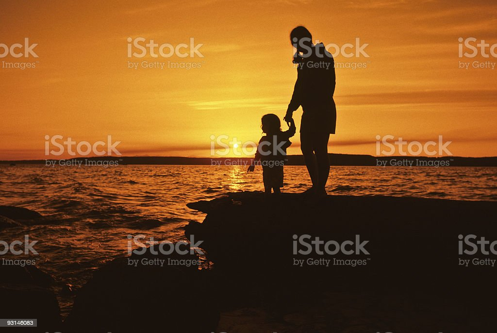 Mother and Daughter, Sunset Silhouette - Royalty-free Adult Stock Photo