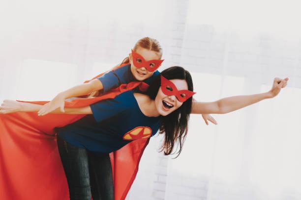 mother and daughter. superhero suits concept. - baby super hero imagens e fotografias de stock